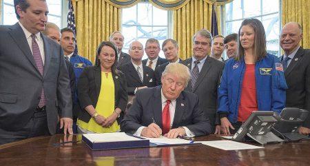Trump signing something